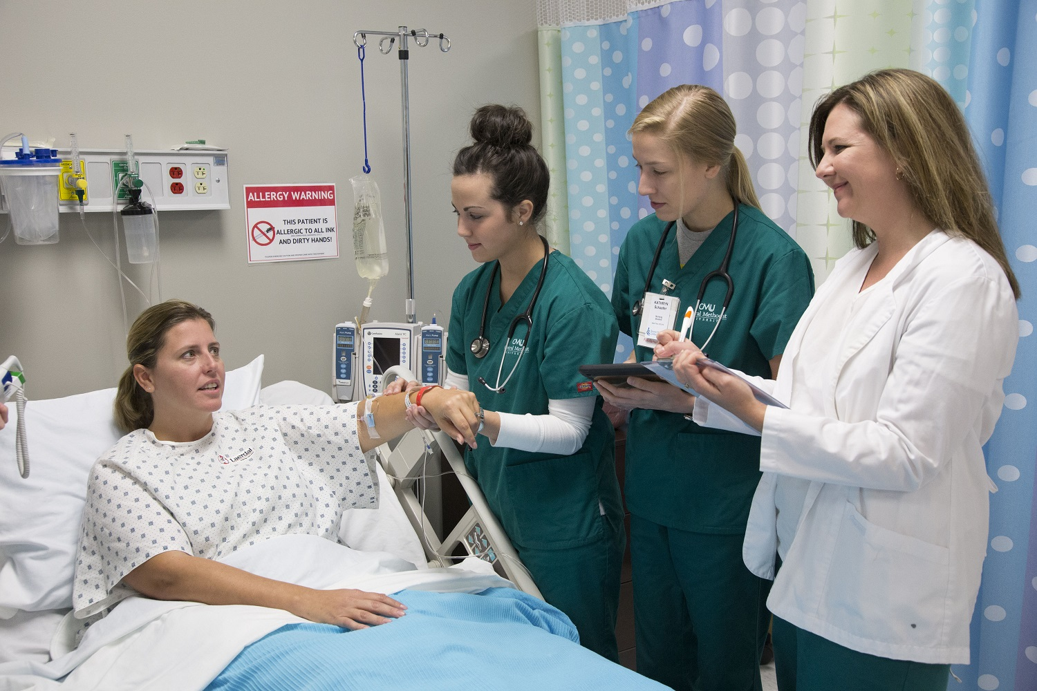 Allied Health students with a patient