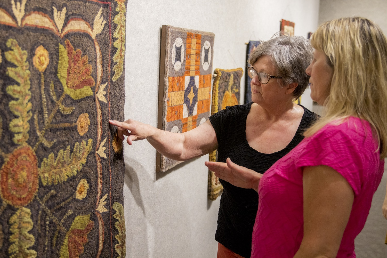 Patrons at the rug exhibit